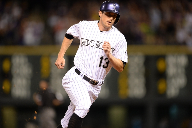 Jul 25, 2014; Denver, CO, USA; Colorado Rockies center fielder Drew Stubbs (13) heads home to score in the seventh inning against the Pittsburgh Pirates at Coors Field. Mandatory Credit: Ron Chenoy-USA TODAY Sports