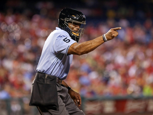 Jul 25, 2014; Philadelphia, PA, USA; Home plate umpire C.B. Bucknor (54) calls a strike during the sixth inning of a game between the Philadelphia Phillies and Arizona Diamondbacks at Citizens Bank Park. Mandatory Credit: Bill Streicher-USA TODAY Sports