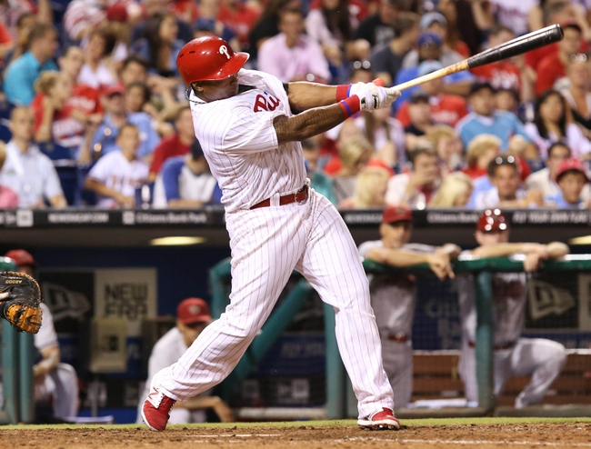 Jul 25, 2014; Philadelphia, PA, USA; Philadelphia Phillies right fielder Marlon Byrd (3) hits a double during the seventh inning of a game against the Arizona Diamondbacks at Citizens Bank Park. The Phillies won 9-5. Mandatory Credit: Bill Streicher-USA TODAY Sports