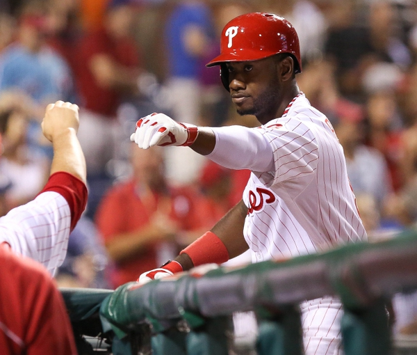 Jul 25, 2014; Philadelphia, PA, USA; Philadelphia Phillies left fielder Domonic Brown (9) is congratulated by teammates after hitting a two RBI home run during the seventh inning of a game against the Arizona Diamondbacks at Citizens Bank Park. The Phillies won 9-5. Mandatory Credit: Bill Streicher-USA TODAY Sports
