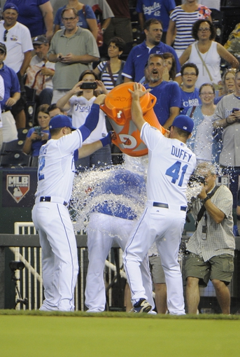 Jul 25, 2014; Kansas City, MO, USA; Kansas City Royals catcher Brett Hayes (12) and starting pitcher Danny Duffy (41) pour water on designated hitter Billy Butler (center) after the game against the Cleveland Indians at Kauffman Stadium. Kansas City won the game 6-4. Mandatory Credit: John Rieger-USA TODAY Sports