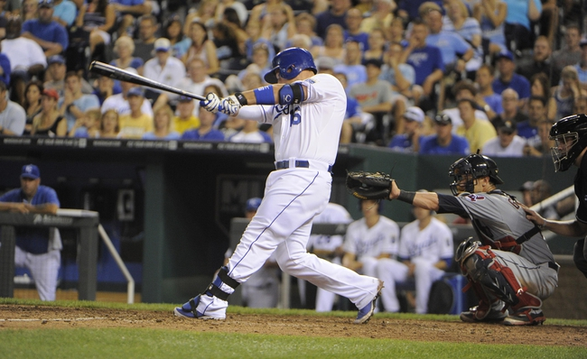Jul 25, 2014; Kansas City, MO, USA; Kansas City Royals designated hitter Billy Butler (16) hits a 2 run home run in the eighth inning against the Cleveland Indians at Kauffman Stadium. Kansas City won the game 6-4. Mandatory Credit: John Rieger-USA TODAY Sports