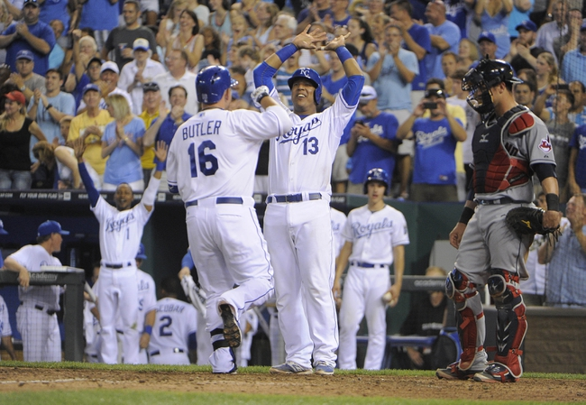 Jul 25, 2014; Kansas City, MO, USA; Kansas City Royals designated hitter Billy Butler (16) celebrates with catcher Salvador Perez (13) after hitting a 2 run home run in the eighth inning against the Cleveland Indians at Kauffman Stadium. Kansas City won the game 6-4. Mandatory Credit: John Rieger-USA TODAY Sports
