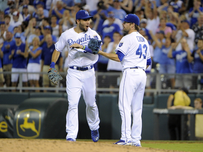 Jul 25, 2014; Kansas City, MO, USA; Kansas City Royals first baseman Eric Hosmer (35) celebrates with relief pitcher Aaron Crow (43) after the game against the Cleveland Indians at Kauffman Stadium. Kansas City won the game 6-4. Mandatory Credit: John Rieger-USA TODAY Sports