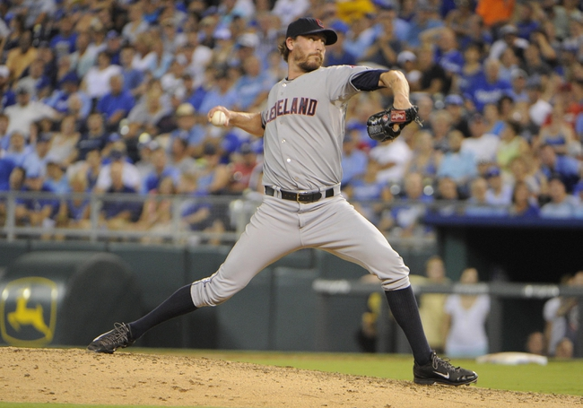 Jul 25, 2014; Kansas City, MO, USA; Cleveland Indians relief pitcher John Axford (44) delivers a pitch against the Kansas City Royals in the eighth inning at Kauffman Stadium. Kansas City won the game 6-4. Mandatory Credit: John Rieger-USA TODAY Sports