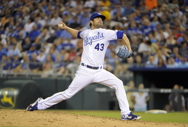 Jul 25, 2014; Kansas City, MO, USA; Kansas City Royals relief pitcher Aaron Crow (43) delivers a pitch in the ninth inning against the Cleveland Indians at Kauffman Stadium. Kansas City won the game 6-4. Mandatory Credit: John Rieger-USA TODAY Sports