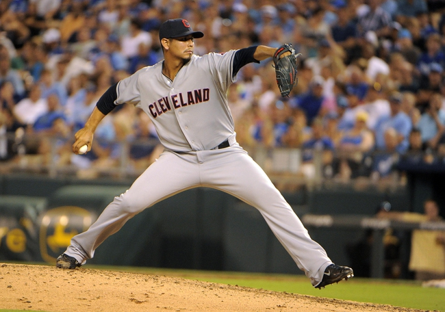 Jul 25, 2014; Kansas City, MO, USA; Cleveland Indians relief pitcher Carlos Carrasco (59) delivers a pitch against the Kansas City Royals in the seventh inning at Kauffman Stadium. Kansas City won the game 6-4. Mandatory Credit: John Rieger-USA TODAY Sports