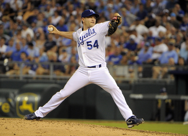 Jul 25, 2014; Kansas City, MO, USA; Kansas City Royals relief pitcher Jason Frasor (54) delivers a pitch against the Cleveland Indians in the seventh inning at Kauffman Stadium. Kansas City won the game 6-4. Mandatory Credit: John Rieger-USA TODAY Sports