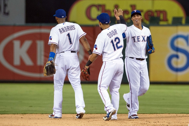 Jul 25, 2014; Arlington, TX, USA; Texas Rangers shortstop Elvis Andrus (1) and second baseman Rougned Odor (12) and center fielder Leonys Martin (2) celebrate the win over the Oakland Athletics at Globe Life Park in Arlington. The Rangers defeated the Athletics 4-1. Mandatory Credit: Jerome Miron-USA TODAY Sports