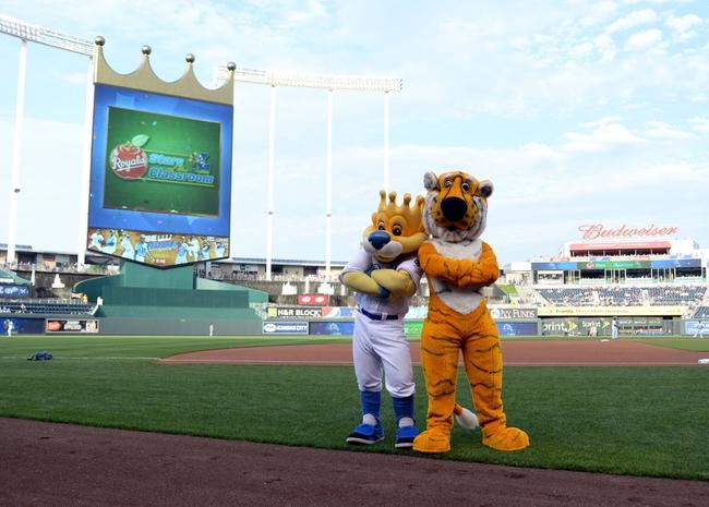 Jul 25, 2014; Kansas City, MO, USA; Kansas City Royals mascot Sliggerrr (left) poses with Missouri mascot Truman the Tiger before the game against the Cleveland Indians at Kauffman Stadium. Kansas City won the game 6-4. Mandatory Credit: John Rieger-USA TODAY Sports