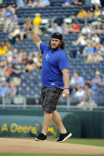Jul 25, 2014; Kansas City, MO, USA; Missouri Tigers offensive lineman Evan Boehm waves to the crowd before throwing out the ceremonial first pitch before the game between the Kansas City Royals and Cleveland Indians at Kauffman Stadium. Kansas City won the game 6-4. Mandatory Credit: John Rieger-USA TODAY Sports