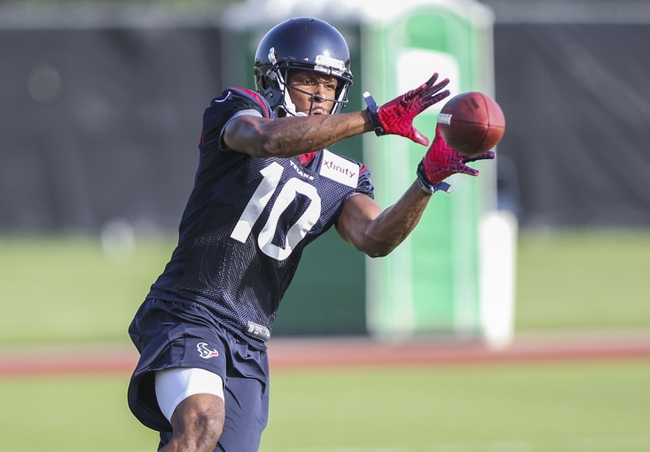 Jul 26, 2014; Houston, TX, USA; Houston Texans wide receiver DeAndre Hopkins (10) catches a pass during training camp at Houston Methodist Training Center. Mandatory Credit: Troy Taormina-USA TODAY Sports