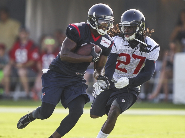 Jul 26, 2014; Houston, TX, USA; Houston Texans wide receiver Uzoma Nwachukwu (17) catches a pass as defensive back Josh Victorian (27) defends during training camp at Houston Methodist Training Center. Mandatory Credit: Troy Taormina-USA TODAY Sports