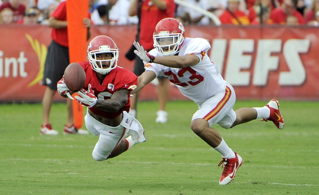 Jul 26, 2014; St. Joseph, MO, USA; Kansas City Chiefs cornerback Phillip Gaines (23) defends against wide receiver Kyle Williams (19) during training camp at Missouri Western State University. Mandatory Credit: John Rieger-USA TODAY Sports
