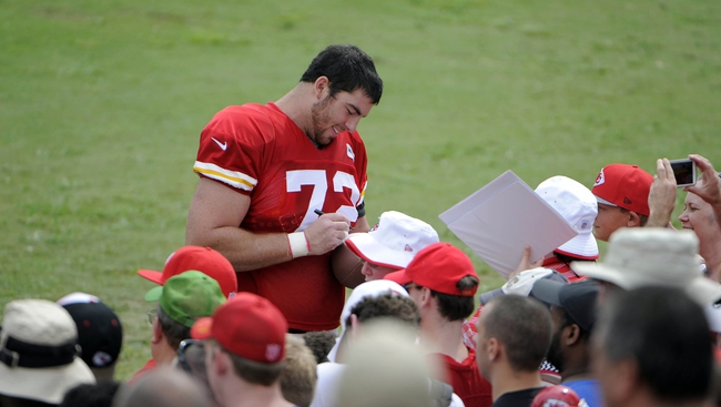 Jul 26, 2014; St. Joseph, MO, USA; Kansas City Chiefs offensive tackle Eric Fisher (72) signs autographs after practice during training camp at Missouri Western State University. Mandatory Credit: John Rieger-USA TODAY Sports