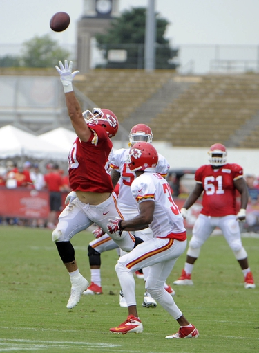 Jul 26, 2014; St. Joseph, MO, USA; Kansas City Chiefs tight end Anthony Fasano (80) is unable to catch this pass against cornerback Marcus Cooper (31) during training camp at Missouri Western State University. Mandatory Credit: John Rieger-USA TODAY Sports
