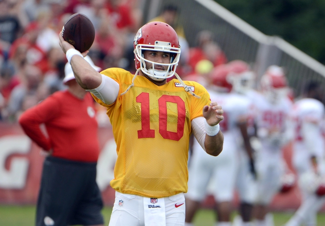 Jul 26, 2014; St. Joseph, MO, USA; Kansas City Chiefs quarterback Chase Daniel (10) tosses the ball during training camp at Missouri Western State University. Mandatory Credit: John Rieger-USA TODAY Sports