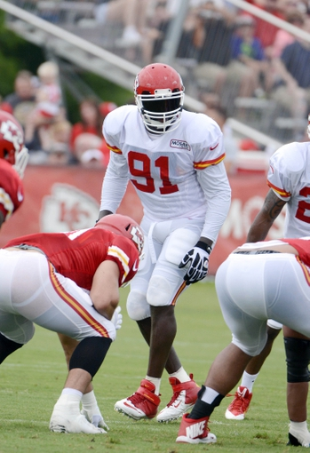 Jul 26, 2014; St. Joseph, MO, USA; Kansas City Chiefs linebacker Tamba Hali (91) lines up during training camp at Missouri Western State University. Mandatory Credit: John Rieger-USA TODAY Sports