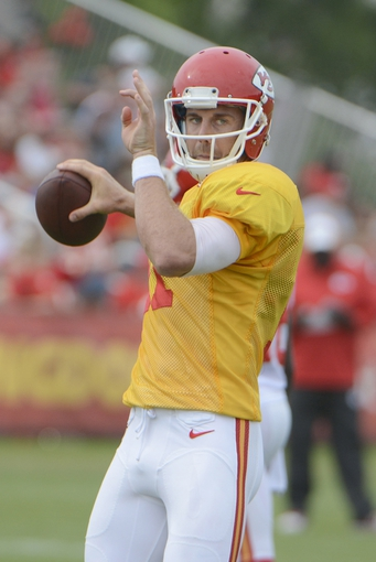 Jul 26, 2014; St. Joseph, MO, USA; Kansas City Chiefs quarterback Alex Smith (11) throws the ball during training camp at Missouri Western State University. Mandatory Credit: John Rieger-USA TODAY Sports
