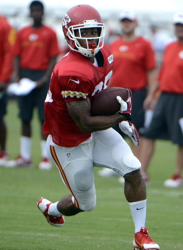 Jul 26, 2014; St. Joseph, MO, USA; Kansas City Chiefs running back Charcandrick West (35) runs after a catch during training camp at Missouri Western State University. Mandatory Credit: John Rieger-USA TODAY Sports