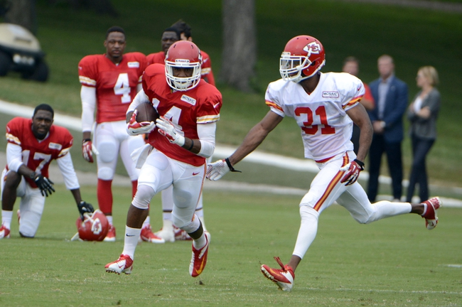 Jul 26, 2014; St. Joseph, MO, USA; Kansas City Chiefs wide receiver Darryl Surgent (14) runs after a catch against cornerback Marcus Cooper (31) during training camp at Missouri Western State University. Mandatory Credit: John Rieger-USA TODAY Sports