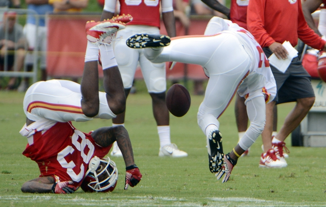 Jul 26, 2014; St. Joseph, MO, USA; Kansas City Chiefs defensive back Kevin Rutland (right) breaks up a pass intended for wide receiver Fred Williams (83) during training camp at Missouri Western State University. Mandatory Credit: John Rieger-USA TODAY Sports