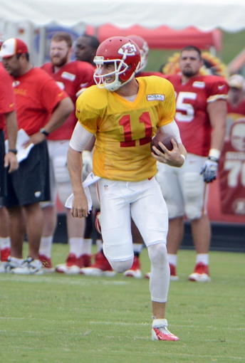 Jul 26, 2014; St. Joseph, MO, USA; Kansas City Chiefs quarterback Alex Smith (11) runs the ball during training camp at Missouri Western State University. Mandatory Credit: John Rieger-USA TODAY Sports