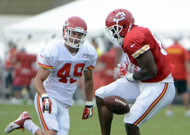Jul 26, 2014; St. Joseph, MO, USA; Kansas City Chiefs tight end Richard Gordon (81) is unable to catch this pass while defended by safety Daniel Sorensen (49) during training camp at Missouri Western State University. Mandatory Credit: John Rieger-USA TODAY Sports