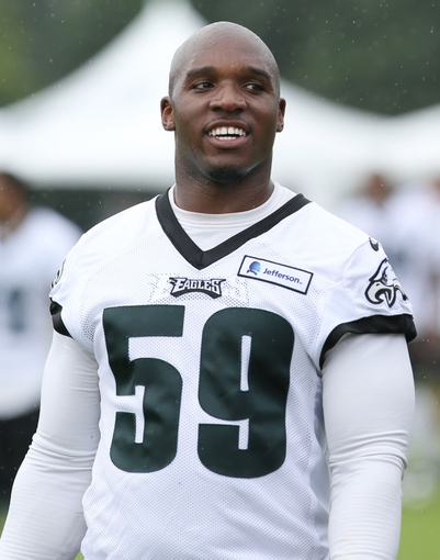 Jul 26, 2014; Philadelphia, PA, USA; Philadelphia Eagles inside linebacker DeMeco Ryans (59) walks off the field after training camp practice at the Novacare Complex in Philadelphia PA. Mandatory Credit: Bill Streicher-USA TODAY Sports