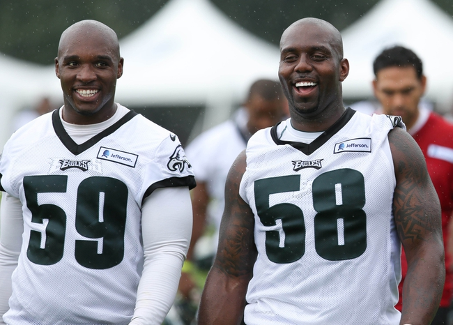 Jul 26, 2014; Philadelphia, PA, USA; Philadelphia Eagles inside linebacker DeMeco Ryans (59) and outside linebacker Trent Cole (58) walk off the field after training camp practice at the Novacare Complex in Philadelphia PA. Mandatory Credit: Bill Streicher-USA TODAY Sports