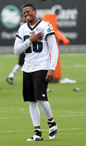 Jul 26, 2014; Philadelphia, PA, USA; Philadelphia Eagles cornerback Cary Williams (26) laughs as he walks off the field after training camp practice at the Novacare Complex in Philadelphia PA. Mandatory Credit: Bill Streicher-USA TODAY Sports