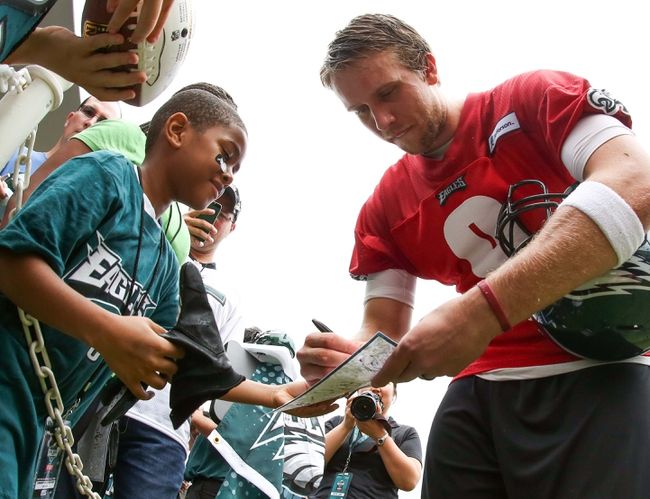 Jul 26, 2014; Philadelphia, PA, USA; Philadelphia Eagles quarterback Nick Foles (9) signs autographs for fans after daily practice training camp at the Novacare Complex in Philadelphia PA. Mandatory Credit: Bill Streicher-USA TODAY Sports