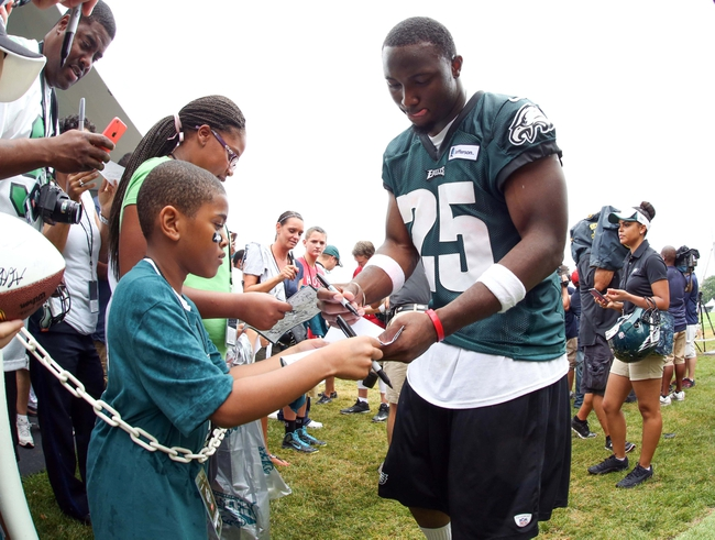 Jul 26, 2014; Philadelphia, PA, USA; Philadelphia Eagles running back LeSean McCoy (25) signs autographs for fans after daily practice training camp at the Novacare Complex in Philadelphia PA. Mandatory Credit: Bill Streicher-USA TODAY Sports