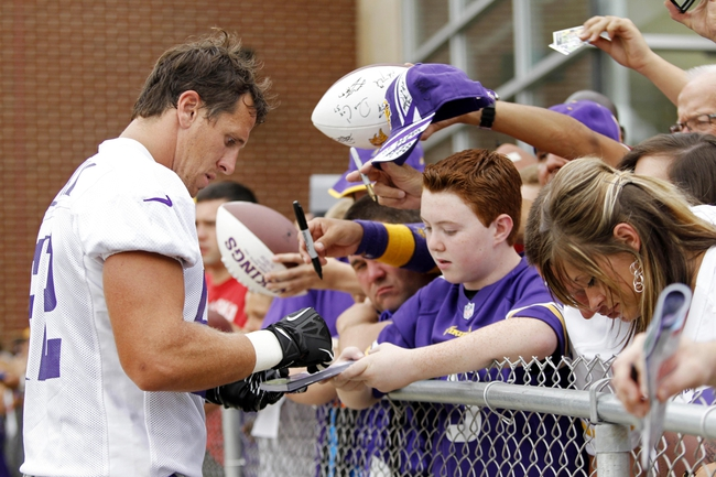 Jul 25, 2014; Mankato, MN, USA; Minnesota Vikings linebacker Chad Greenway (52) signs autographs for fans after the first day of practice at training camp at Minnesota State University. Mandatory Credit: Bruce Kluckhohn-USA TODAY Sports