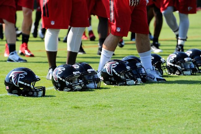 Jul 26, 2014; Atlanta, GA, USA; Atlanta Falcons helmets get retrieved by players during training camp at Falcons Training Complex. Mandatory Credit: Dale Zanine-USA TODAY Sports