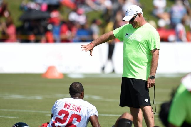 Jul 26, 2014; Atlanta, GA, USA; Atlanta Falcons head coach Mike Smith thaws to cornerback Josh Wilson (26) on the field during training camp at Falcons Training Complex. Mandatory Credit: Dale Zanine-USA TODAY Sports