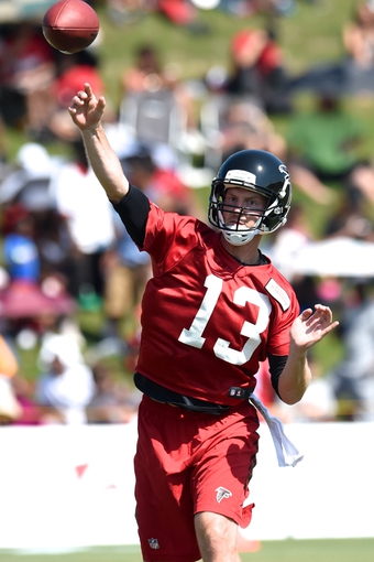 Jul 26, 2014; Atlanta, GA, USA; Atlanta Falcons quarterback T.J. Yates (13) passes on the field during training camp at Falcons Training Complex. Mandatory Credit: Dale Zanine-USA TODAY Sports