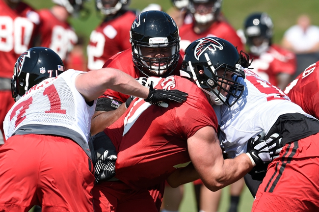 Jul 26, 2014; Atlanta, GA, USA; Atlanta Falcons offensive tackle Jake Matthews (70) (second from right) blocks during a drill on the field during training camp at Falcons Training Complex. Mandatory Credit: Dale Zanine-USA TODAY Sports