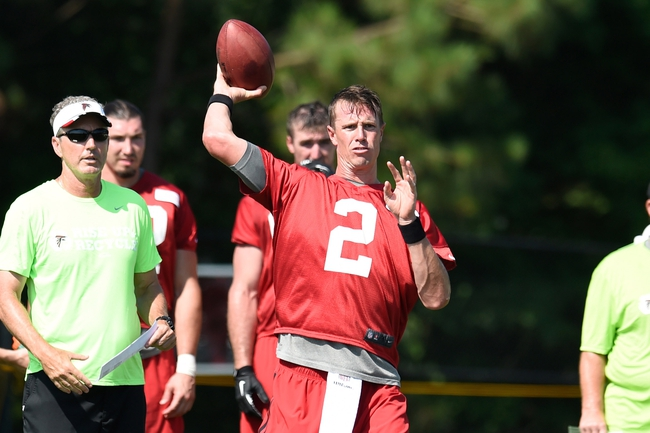 Jul 26, 2014; Atlanta, GA, USA; Atlanta Falcons quarterback Matt Ryan (2) passes the ball on the field during training camp at Falcons Training Complex. Mandatory Credit: Dale Zanine-USA TODAY Sports