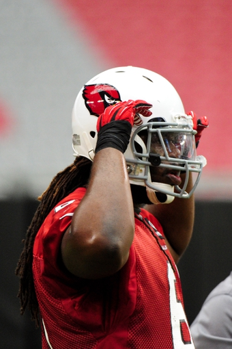 Jul 26, 2014; Tempe, AZ, USA; Arizona Cardinals offensive guard Jonathan Cooper (61) looks on during training camp at University of Phoenix. Mandatory Credit: Matt Kartozian-USA TODAY Sports