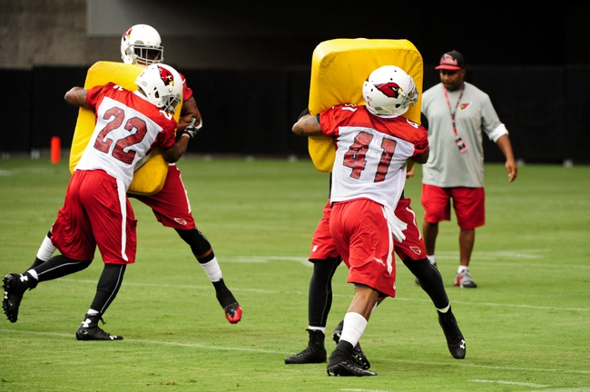Jul 26, 2014; Tempe, AZ, USA; Arizona Cardinals free safety Tony Jefferson (22) and defensive back Eddie Whitley (41) perform blocking drills during training camp at University of Phoenix. Mandatory Credit: Matt Kartozian-USA TODAY Sports
