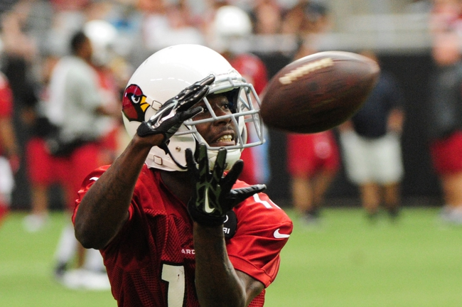 Jul 26, 2014; Tempe, AZ, USA; Arizona Cardinals wide receiver John Brown (12) makes a catch during training camp at University of Phoenix. Mandatory Credit: Matt Kartozian-USA TODAY Sports