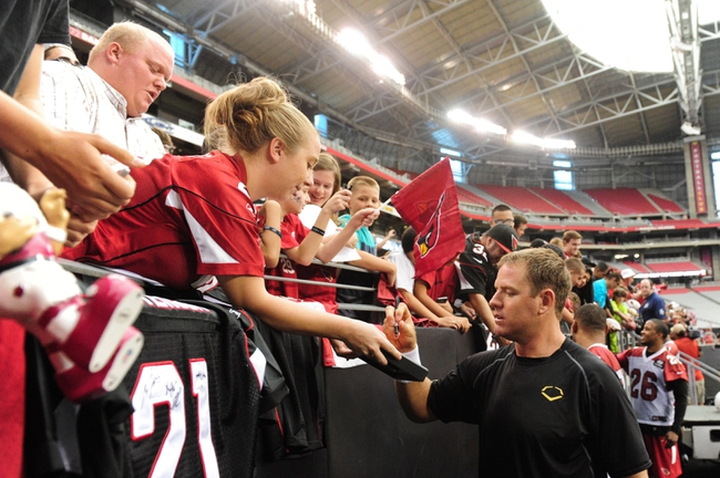 Jul 26, 2014; Tempe, AZ, USA; Arizona Cardinals quarterback Carson Palmer (3) signs autographs for fans during training camp at University of Phoenix. Mandatory Credit: Matt Kartozian-USA TODAY Sports