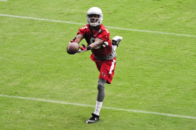 Jul 26, 2014; Tempe, AZ, USA; Arizona Cardinals wide receiver Walt Powell (83) makes a fingertip catch during training camp at University of Phoenix. Mandatory Credit: Matt Kartozian-USA TODAY Sports
