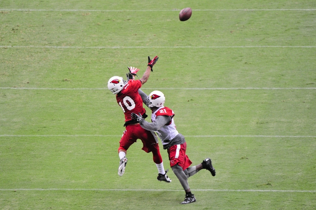 Jul 26, 2014; Tempe, AZ, USA; Arizona Cardinals wide receiver Brittan Golden (10) tries to catch the ball as cornerback Patrick Peterson (21) defends during training camp at University of Phoenix. Mandatory Credit: Matt Kartozian-USA TODAY Sports