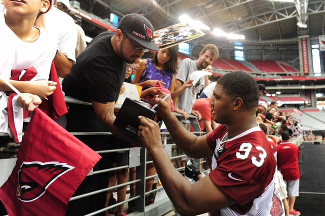 Jul 26, 2014; Tempe, AZ, USA; Arizona Cardinals defensive end Calais Campbell (93) signs autographs for fans during training camp at University of Phoenix. Mandatory Credit: Matt Kartozian-USA TODAY Sports