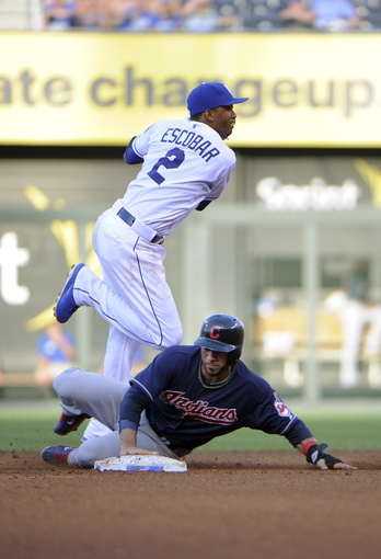 Jul 26, 2014; Kansas City, MO, USA; Cleveland Indians third baseman Mike Aviles (4) is out at second base as Kansas City Royals shortstop Alcides Escobar (2) turns a double play in the fourth inning at Kauffman Stadium. Mandatory Credit: John Rieger-USA TODAY Sports