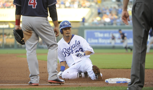 Jul 26, 2014; Kansas City, MO, USA; Kansas City Royals right fielder Norichika Aoki (23) slides into third base with a triple in the fourth inning against the Cleveland Indians at Kauffman Stadium. Mandatory Credit: John Rieger-USA TODAY Sports