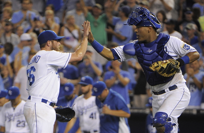 Jul 26, 2014; Kansas City, MO, USA; Kansas City Royals relief pitcher Greg Holland (56) celebrates with catcher Salvador Perez (13) after the game against the Cleveland Indians at Kauffman Stadium. Kansas City won the game 7-5. Mandatory Credit: John Rieger-USA TODAY Sports