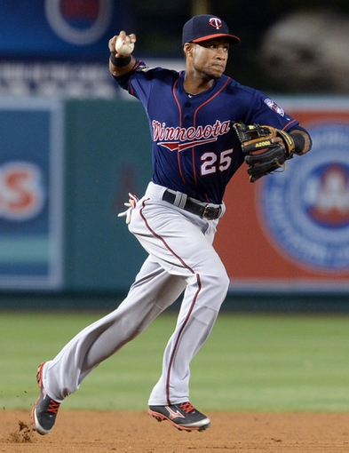 Jun 25, 2014; Anaheim, CA, USA; Minnesota Twins shortstop Pedro Florimon (25) makes a play in the sixth inning of the game against the Los Angeles Angels at Angel Stadium of Anaheim. Mandatory Credit: Jayne Kamin-Oncea-USA TODAY Sports